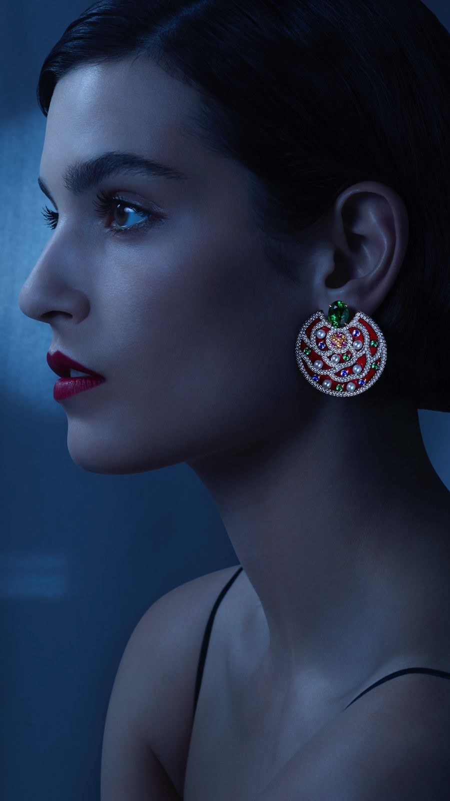 The model wearing the folflore earrings