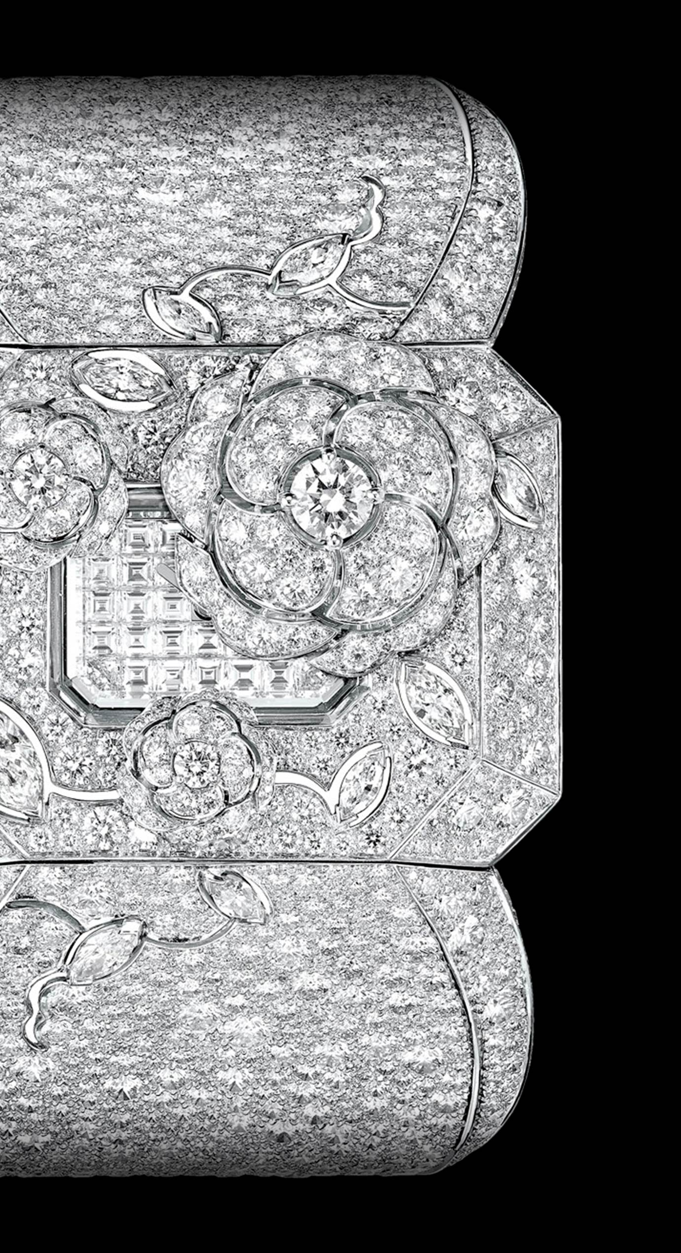 """""""Médaillon"""" watch. The back of this medallion composed of engraved rock crystal, pearls and diamonds (including one 5.32-carat Fancy Light Yellow pear-cut diamond) conceals a diamond-paved watch dial. The medallion hangs elegantly from an 18K white gold sautoir set with 587 diamonds. - Back"""