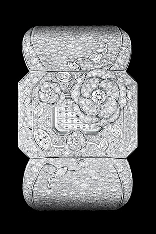 """""""Médaillon"""" watch. The back of this medallion composed of engraved rock crystal, pearls and diamonds (including one 5.32-carat Fancy Light Yellow pear-cut diamond) conceals a diamond-paved watch dial. The medallion hangs elegantly from an 18K white gold sautoir set with 587 diamonds."""