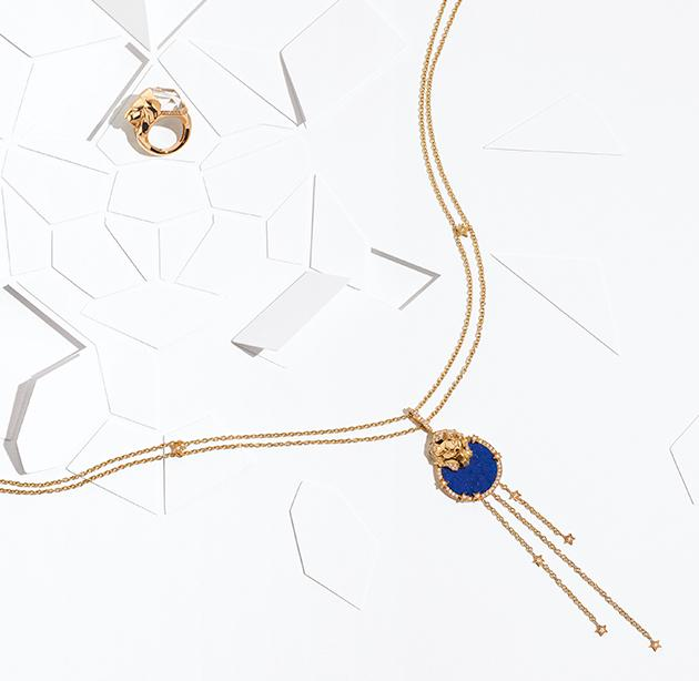 Still-life visual with the LION SCULPTURAL ring in gold, diamonds and quartz and SOUS LE SIGNE DU LION necklace in gold, diamonds and lapis lazuli.