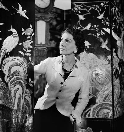 Gabrielle Chanel in front of her Coromandel lacquer screens - 31 rue Cambon in Paris, 1937