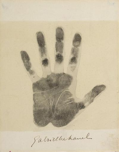 Print of Gabrielle Chanel's left hand, with her signature.